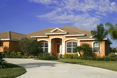 Upscale home with circular driveway Stock Image