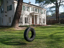 Upscale home with shaded front yard and swing Royalty Free Stock Photos