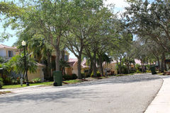 Upscale houses on a suburban street Stock Images