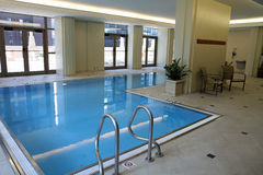 Upscale indoor swimming pool Stock Images