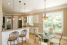 Upscale kitchen and dining room Royalty Free Stock Photos