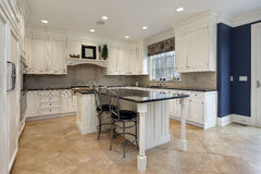 Upscale kitchen with granite island Stock Photography
