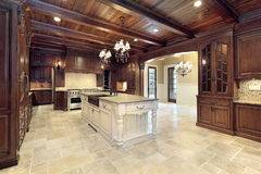 Upscale kitchen with wood ceilings Stock Images