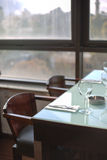 Upscale modern restaurant. Table and place setting by a window in a modern upscale restaurant Stock Photo