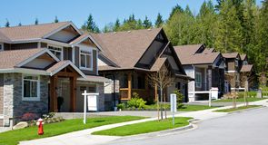 Upscale neighborhood. Upscale houses on an upper class neighborhood on a sunny summer day Royalty Free Stock Photography