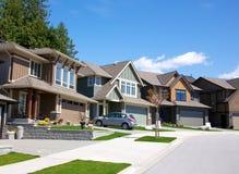 Upscale neighborhood. Upscale houses on an upper class neighborhood on a sunny summer day Stock Photography