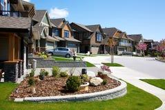 Upscale neighborhood. Upscale houses on an upper class neighborhood on a sunny summer day Stock Images