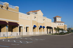 Upscale pastel commercial mall. Upscale pastel strip mall with awnings and corner clock tower Stock Images