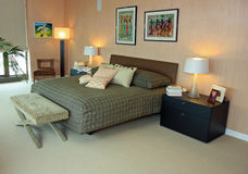 Upscale penthouse master bedroom Stock Images