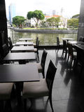 Upscale riverside dining. An image showing the dining area of an upscale river side restaurant, situated by the famous Singapore River in the heart of the Royalty Free Stock Image