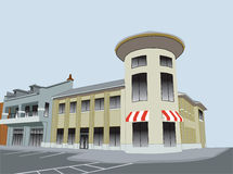 Upscale shopping plaza. Commercial strip mall with circular corner tower and striped awnings