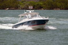 Upscale Sport Fishing Boat on the Florida Intra-coastal Waterway. Upscale sport fishing boat speeding across the florida intra-coastal waterway off Miami Beach royalty free stock photos