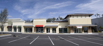 Upscale strip mall pano. Stitched panoramic of an upscale storefront mall with tin roof and colorful awnings Royalty Free Stock Photo