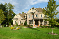 Upscale suburban house. With landscaped large yard Royalty Free Stock Photos