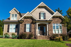 Upscale suburban house. Exterior and front lawn Stock Photography