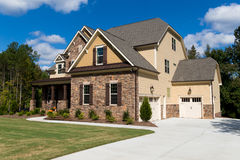 Upscale suburban house. Exterior with front lawn and driveway Royalty Free Stock Photography