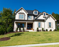 Upscale suburban house. Exterior with large front lawn Royalty Free Stock Image