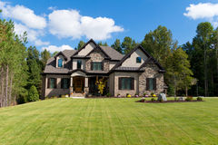 Upscale suburban house. Exterior with large front lawn Stock Images