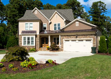 Upscale suburban house. With landscaped front yard Royalty Free Stock Photo