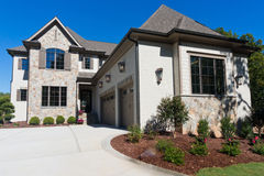 Upscale suburban house. With large garage Royalty Free Stock Photography