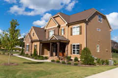 Upscale suburban house. With the large lawn Royalty Free Stock Images