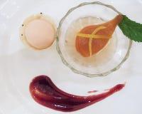 An upscale Thai restaurant serves pear dessert. An upscale Thai restaurant serves a fancy dish of pear dessert with sorbet stock photos