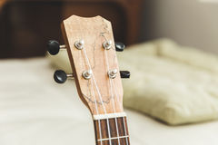 Upscale ukulele with woodgrain finish Stock Image