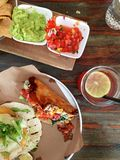 Upscale vegetarian tacos, chips, guacamole, salsa, hibiscus iced tea Stock Photos