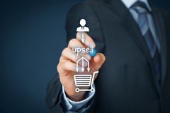 Upsell. On-line (e-shop) marketing concept. Sales technique for more profitable sale. Businessman add  in buying process stock photo