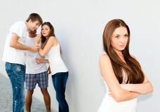 Upset девочка-подросток с злословить друзей Стоковое Изображение RF