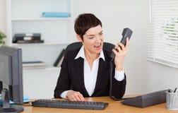 Upset секретарша вызывать Стоковое фото RF