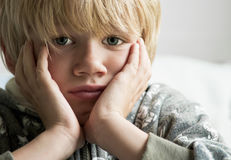 Upset. An upset and sad boy lookng to one side Stock Photo