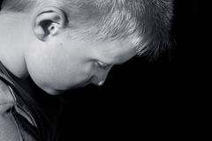 Upset abused frightened child (boy) Stock Photo