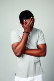 Upset african man on gray background Royalty Free Stock Image
