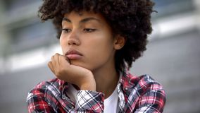Upset afro-american woman portrait, racial discrimination problem, bullying stock images
