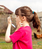 Upset  6 aged girl cheking her  milky teeth. Royalty Free Stock Photography