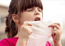 Upset  6 aged girl cheking her  milky teeth Royalty Free Stock Images