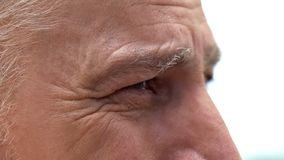Upset aged man crying close-up, feeling pain of loss, emptiness in soul, lonely. Stock photo stock images