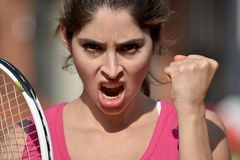 Upset Athlete Colombian Girl Tennis Player. A pretty young Colombian adult female Royalty Free Stock Images