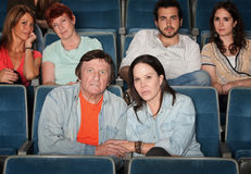 Upset Audience. Group of upset audience watch movie in theater Stock Photos
