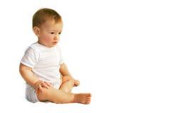Upset baby boy over white. Upset baby boy isolated over white Stock Photography