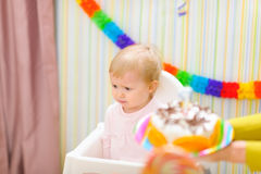 Upset baby on celebration of first birthday Royalty Free Stock Photo