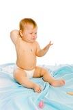 Upset baby in diapers. Studio Stock Images