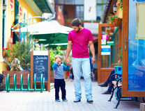 Upset baby and father on the city street Stock Photography