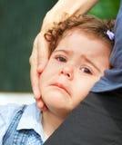Upset baby girl Stock Photos