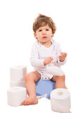 Upset baby on potty Royalty Free Stock Images