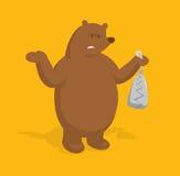 Upset bear holding a trap Stock Photography