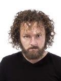 Upset bearded mad man portrait Stock Image