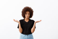 Upset beautiful african girl over light background. Royalty Free Stock Photos