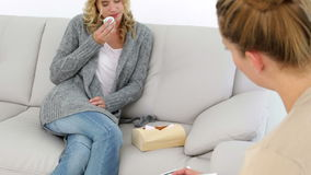 Upset blonde woman talking about her problems. At therapy session stock video